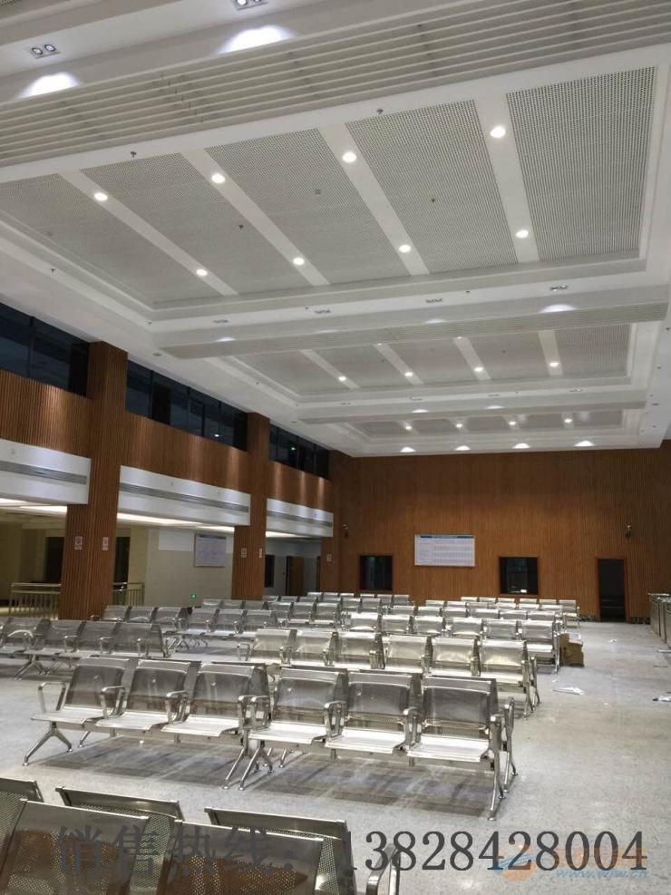 丽水市清水县汽车站冲孔铝单板与木纹长城板的配合安装